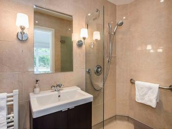 Twin room ensuite with heated floor and towel rail.