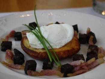 Potato pancake with soft poached egg, black pudding and bacon lardons