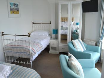 Room 3 Single Bed & Seating Area