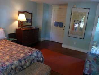 blue room has a queen bed and a futon, private bath room in side