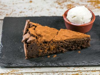 3 Shoes Homemade Chocolate Torte by Lizzie with Baboo Gelato Local Vanilla Ice Cream