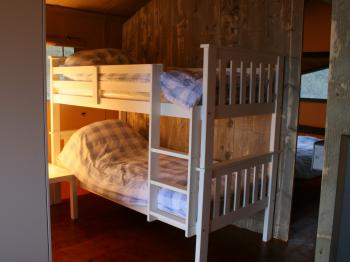 Full size bunk beds, with two wardrobes for plenty of storage