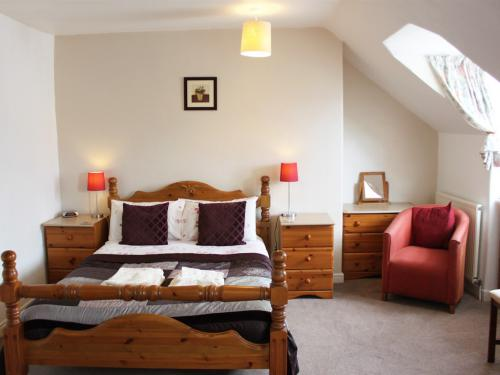3rd Floor Attic Double en-suite. Tall room with memory foam bed, big TV, free films & Freeview. Front facing