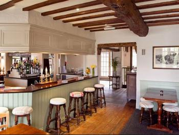 A relaxed bar and dining area close to the games room