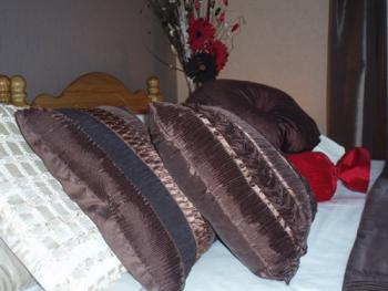 Luxury en-suite Double room with Superking sized bed and tasteful chocolate theme