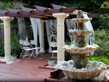 Pergola and fountain in garden