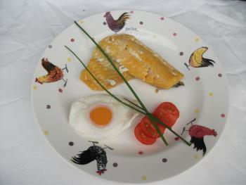Smoked haddock with poached egg from our hens and chives from the herb garden