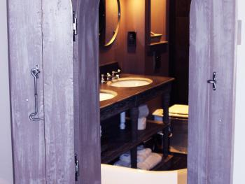 Glimpse of bathroom with shutters open