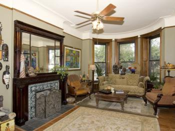 FIRST FLOOR- COMMON AREA- LIVING ROOM w/Ornate Fireplace & Large Oversize Couch & Chairs for Socializing