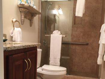 The Sinclair room bathroom offers the privacy of an ensuite with ease of walk in, accessible shower.