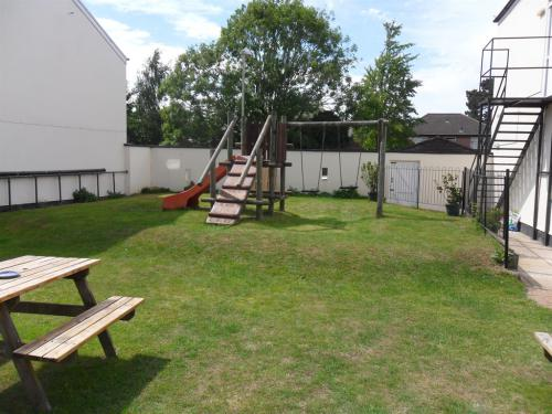 south facing rear secluded garden with children`s play area.