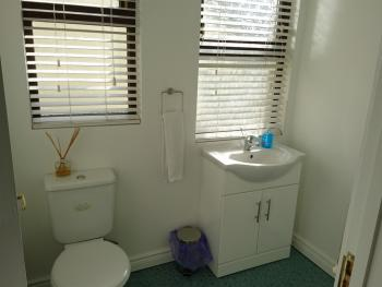 Separate toilet and wash basin on second floor landing outside rooms 3 and 4