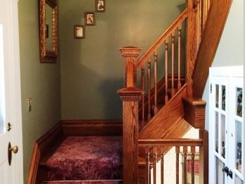 Stairway between second and third floor guest rooms.