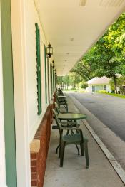 View of exterior sidewalk of room 9 to 4, the motor lodge is located off street making it quiet and steps away from backyard, and lobby and breakfast room.