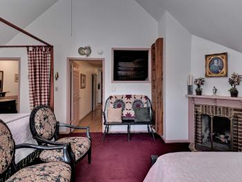The Anderson Room features two king beds, fireplace and private bath