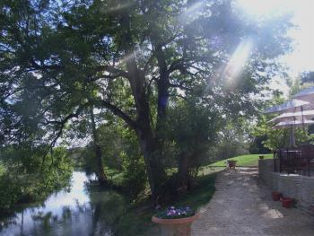 The Fox Inn - The River Windrush running through our Garden