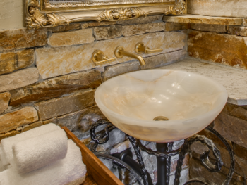 Vessel Sink with Iron stand in Stone bathroom of Olde Rose Suite.