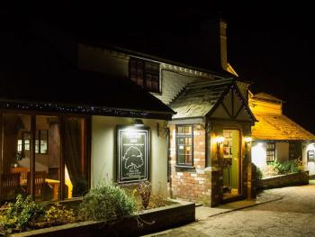 Night time image of outside of the Inn