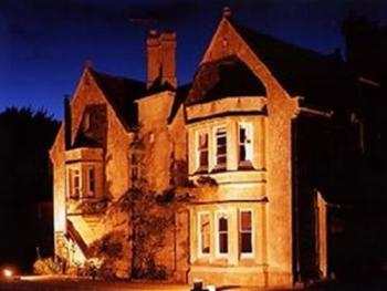 Burcombe Manor - Exterior view at night