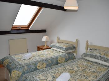 Twin Beds in the Wistaria Cottage