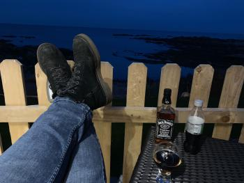 Evening drinks on the deck overlooking the sea