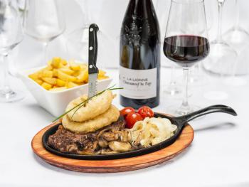 Our restaurant menu : Local Striploin Steak cooked to your liking served on a hot sizzle pan