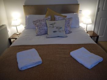 Midships, king sized double bed with ensuite shower, overlooking the front of the pub with sea glimpses
