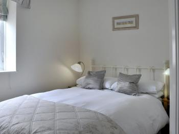 Smaller room at rear of house on first floor with comfy standard sized double bed and nice ensuite shower room with power shower.