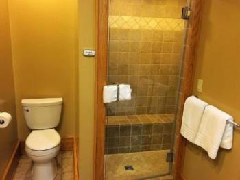Steam shower in Oak with sunflower head and lots of water jets