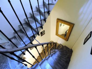 Beautiful period feature staircase to the apartments.