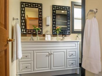Magnolia Chalet bathroom with double vanity and deep soaking tub.