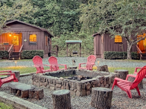 Fire pit (Raccoon cabin on left and Bear cabin on right)