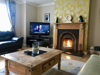 Causeway Holiday Homes - Upstairs Living Room with Real fire
