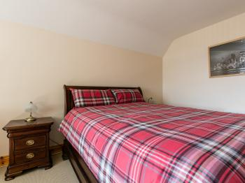 Bedroom 1. Deluxe King Size Bedroom, 2 bed side tables, chest of drawers and build in wardrobe.