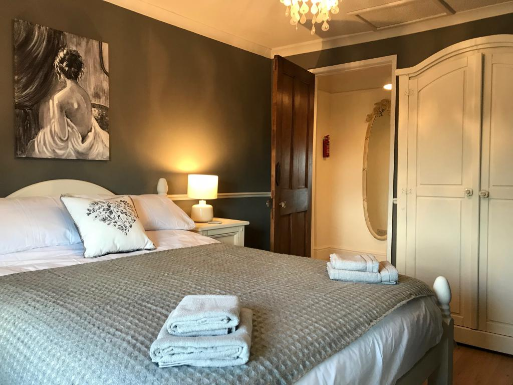 Exquisit double bedroom, with a beautiful view over the Teifi Valley.  There is ample storage, a Victorian fireplace and even a massage mattress!