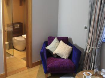The seating area leads into the private, stylish, en-suite shower room in 'The Elm' - Guest Room
