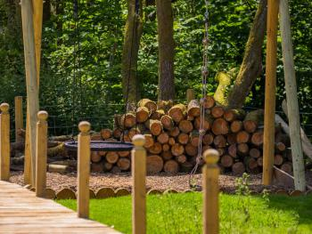 Garden - boardwalk and playground with swings, trampoline and zip wire