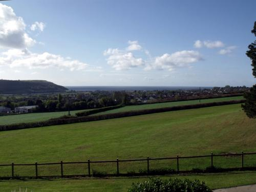 The view from Peacehaven overlooking Seaton and the Axe Valley to the sea.