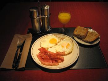 Breakfast at the B&B, bacon and eggs with bread