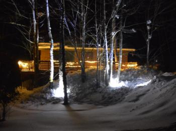 Cabin in the winter at night