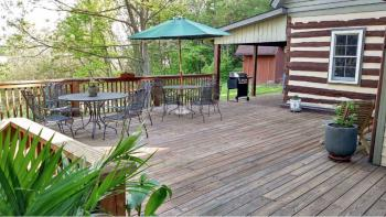 Large deck over looking river and mountain views.