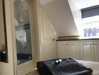 Standard Single with En-suite shower and toilet.