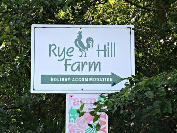 Sign to Rye Hill Farm at road in
