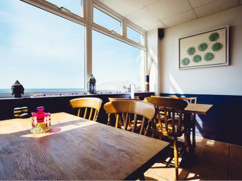 Breakfast, beer or boardgames overlooking the Bay