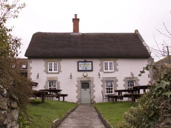 Kingsdon Inn - Exterior view of the chocolate box thatched pub.