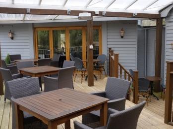 Dining Terrace overlooking riverside garden