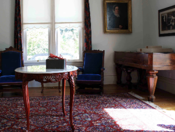 Downstairs parlor where guests can enjoy beautifully restored furniture pieces that are original to the Crane house.