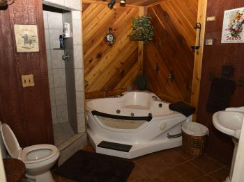 Feed Mill bathroom with jacuzzi tub and separate shower