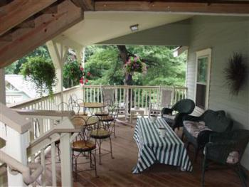 This is just one side of large porch located on second floor where you can relax with a glass of wine.