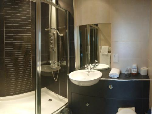Enjoy a walk in hydro-therapy shower with body and overhead jets in one of our superior rooms